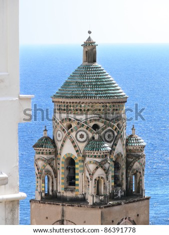 the bell tower of S. Andrea cathedral in Amalfi - Italy - against blue sea - stock photo