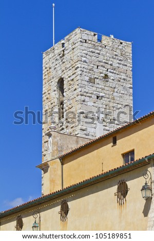 The bell tower of the Cathedral of Our Lady of the Assumption in Antibes. Antibes is a resort town in the Alps-Maritimes department in southeastern France between Cannes and Nice, Cote d'Azur. - stock photo