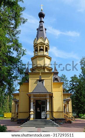 The bell tower of the Church of the Holy apostles Peter and Paul in the village of Vyritsa in the Leningrad region in the summer on a Sunny day.