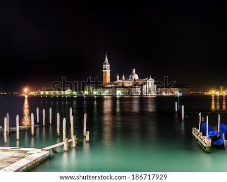 The bell tower of the Saint Giorgio Maggiore Church (view from San Marco embankment) at night - Venice, Italy - stock photo