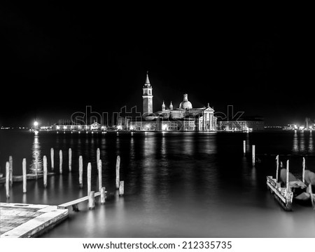 The bell tower of the Saint Giorgio Maggiore Church (view from San Marco embankment) at night - Venice, Italy (black and white) - stock photo