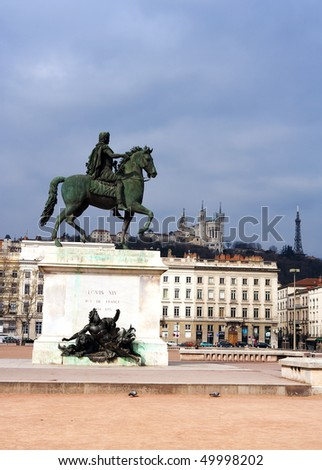 The Bellecour square in Lyon. Statue of Louis and Basilique Fourviere on a background. France.  - stock photo