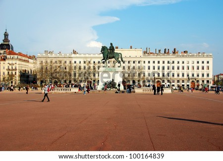 The Bellecour square in Lyon. Statue of Louis XIV. France This is the central square of city of Lyon - stock photo