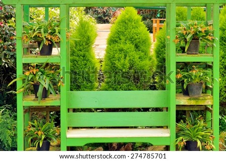 the bench in garden - stock photo