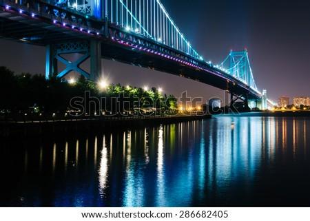 The Benjamin Franklin Bridge at night, in Philadelphia, Pennsylvania. - stock photo