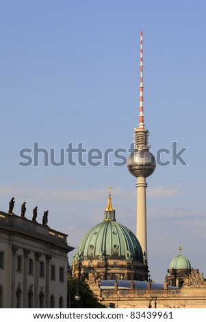 The Berlin Cathedral dome and iconic TV tower. - stock photo