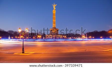 The Berlin Siegessaeule (Victory Column) in Tiergarten park, seen at twilight - stock photo