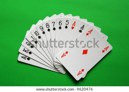 the best bridge cards (A,K,Q,J,10,9,8,7,6,5 spades, A heart, A diamond, A club)  background green, - stock photo