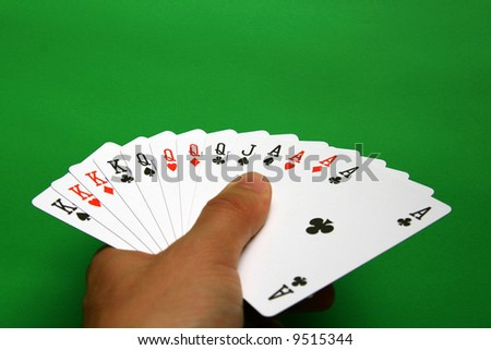the best bridge cards (A,K,Q,J spades, A,K,Q hearts, A,K,Q diamonds, A,K,Q clubs)  background green, - stock photo