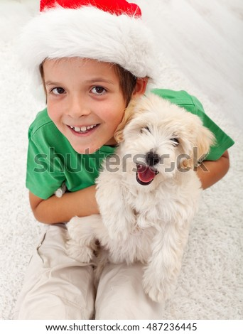 The best christmas present ever - young boy with her puppy dog