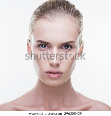 The best model with natural beauty on a white background in the studio, beautiful cheekbones, strong look