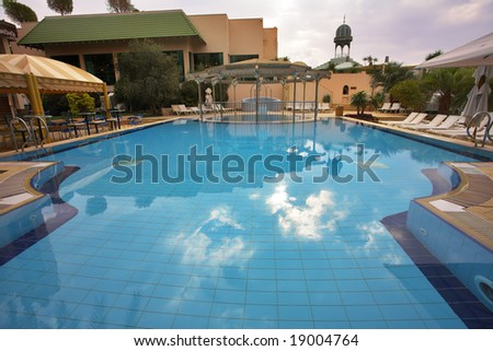 The best rest in magnificent hotel about picturesque pool - stock photo