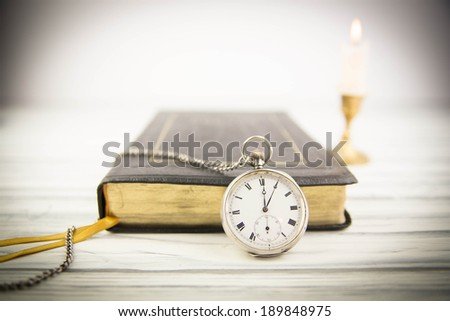 The Bible and pocket watch