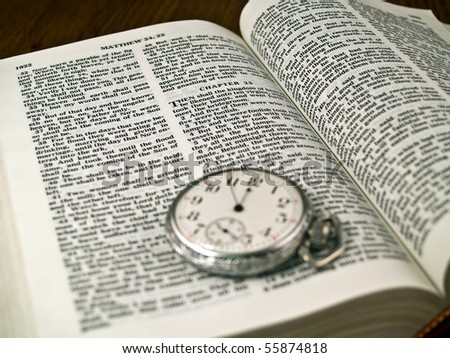 "The Bible opened to Matthew 24: 36 with a Pocketwatch - warm color tone  ""No man knows the day or hour"" - stock photo"