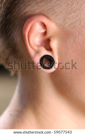 The big aperture in an ear at the teenager