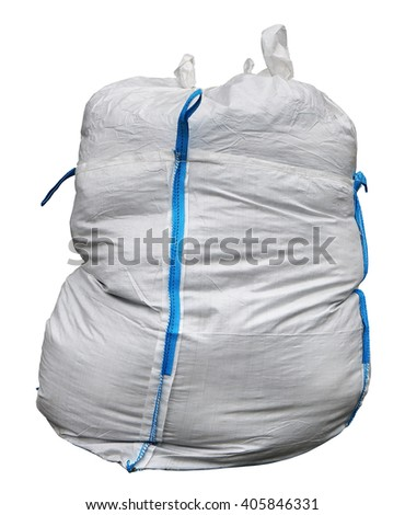 The big bag for construction debris is made of a white synthetic sacking and has blue loops for transportation. Isolated with patch - stock photo