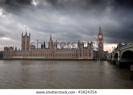 The Big Ben and the Houses of Parliament in London with a dramatic cloudy sky - stock photo