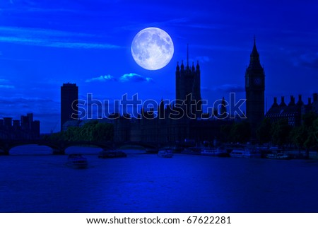 The Big Ben and the river Thames at midnight with a bright full moon - stock photo