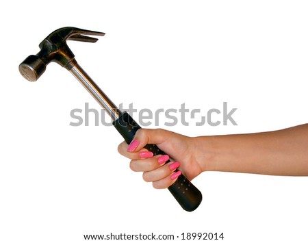The big black hammer in a hand of the girl - stock photo