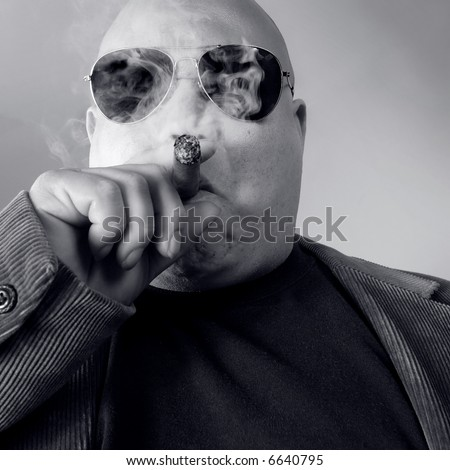 The big Boss, Head Honcho, Top Dog...  An image of the Man in charge, smoking a cigar. - stock photo