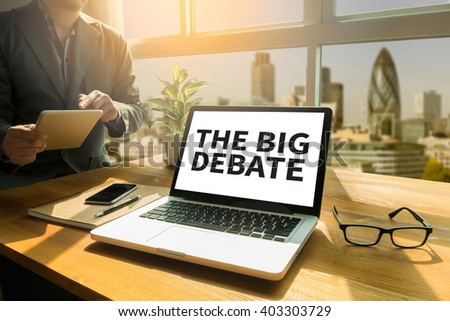 THE BIG DEBATE Thoughtful male person looking to the digital tablet screen, laptop screen,Silhouette and filter sun - stock photo