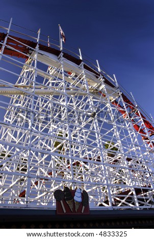 The Big Dipper rolle rcoaster shortly before sunset on the Santa Cruz Boardwalk in California - stock photo