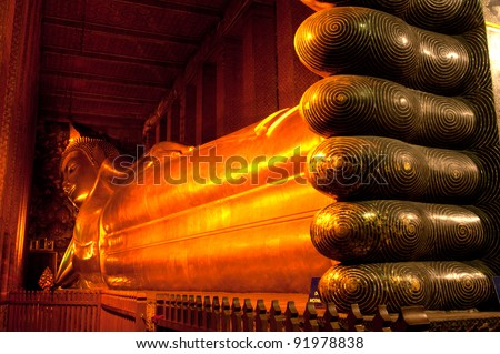 The Big golden Reclining Buddha within Wat Pho is the important in Bangkok, Thailand. - stock photo
