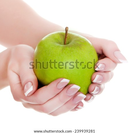 The big green apple in beautiful female hands  - stock photo