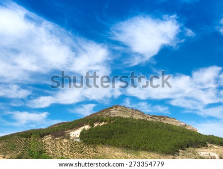 the big green hill and blue sky - stock photo
