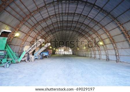 The big hangar for time storage of grain. - stock photo