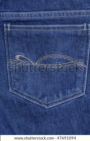 The big hip-pocket of blue shabby jeans with a pattern - stock photo