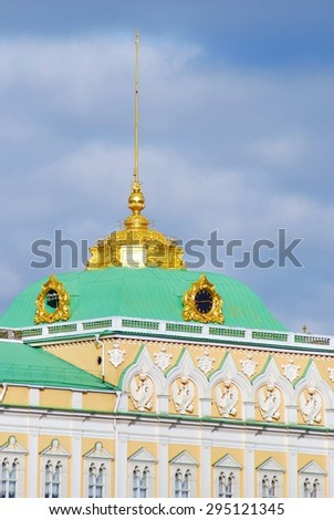 The Big Kremlin Palace of Moscow Kremlin, UNESCO World Heritage Site. Blue sky with clouds background. - stock photo