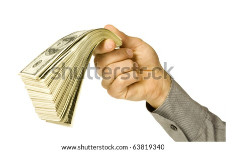 The big pile of money in hand isolated on white background