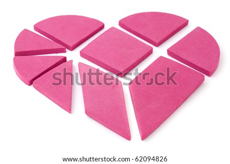 The big pink heart broken into geometrical pieces. - stock photo