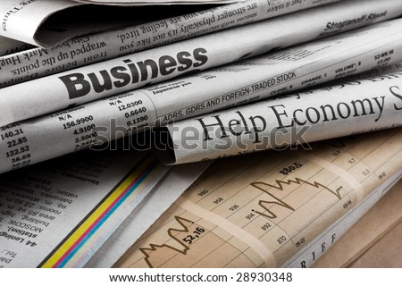The big stack of old business newspapers - stock photo