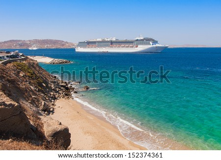 The big tourist liner in a port of island with beach - stock photo