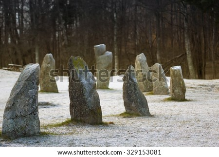 The big tumulus stones standing in the snow field in winter