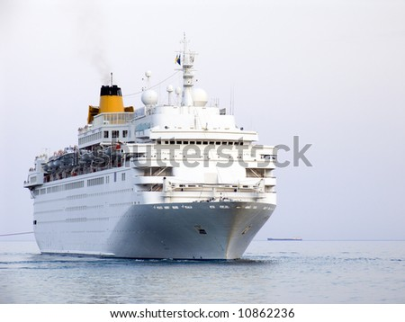 The big white ocean ship on road - stock photo