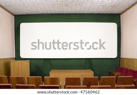 The big white screen in the old  Cinema - stock photo