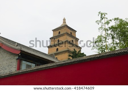 The Big Wild Goose Pagoda located in the city of Xian in Shaanxi Province on an overcast gray sky day.   - stock photo