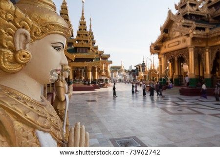 The biggest Buddhist temple Schwedagon pagoda with praying Buddhist people, Rangoon, Burma. - stock photo