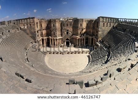 the biggest roman amphitheater in Bosra, Syria - stock photo