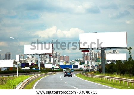 the billboard and road outdoor. - stock photo