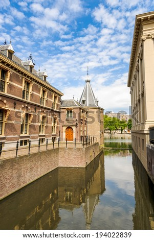 "The Binnenhof (Dutch, literally ""inner court""), is a complex of buildings in The Hague. It has been the location of the Dutch parliament, since 1446, and has been the centre of Dutch politics - stock photo"