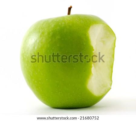 The bitten off green apple - stock photo