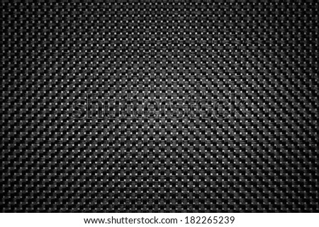 The black background of the surface with a grid pattern. - stock photo