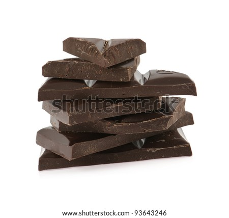 the black broken chocolate lies a pile on a white background