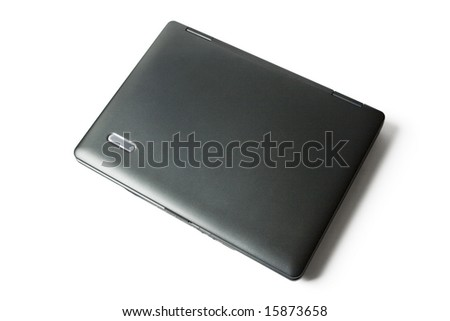 the black closed computer is on a white background - stock photo