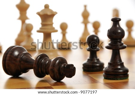 The black king surrendering on a chess board - stock photo