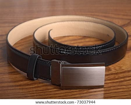The black, leather belt - stock photo